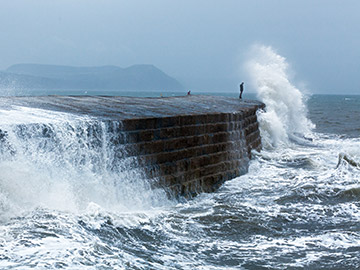 Wave crashing over a breakwater