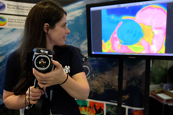 Exhibitor demonstrating an infrared camera